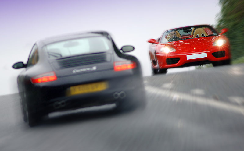 Commercial photography by Peter Ashby-Hayter: Porsche Carrera S rushing past a Ferrari 360 Spider